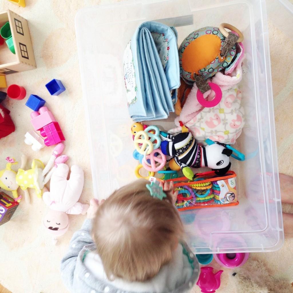 Organizing Elizabeth's baby toys to be stored.