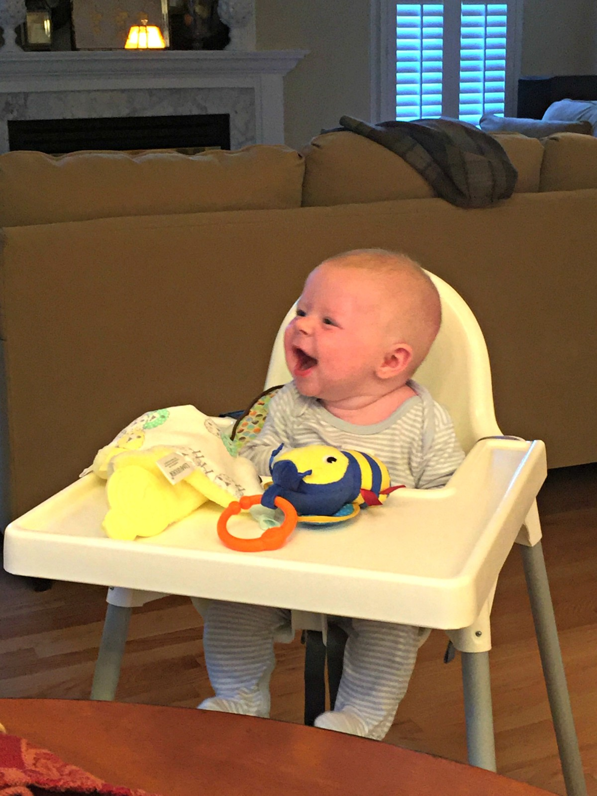 Trying out the high chair for the first time.